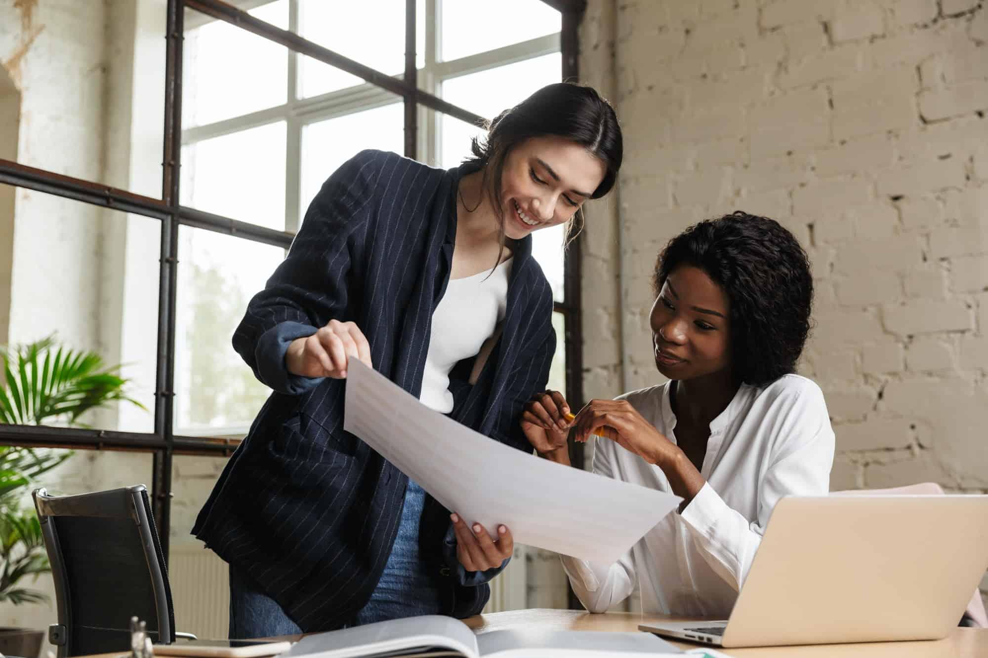 Confident smart women entrepreneurs working